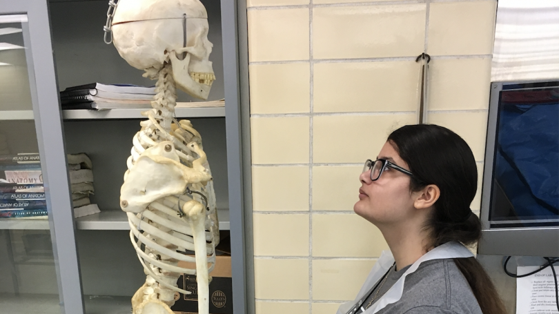 Delaney Thornton locks eyes with a human skeleton